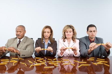 breaking: Businesspeople breaking pencils Stock Photo