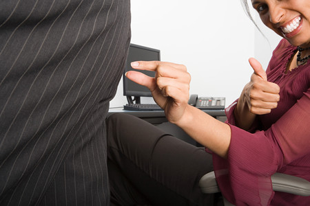 pinching: Businesswoman pinching colleagues buttock Stock Photo
