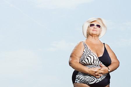thinking woman: Senior woman wearing a swimming costume