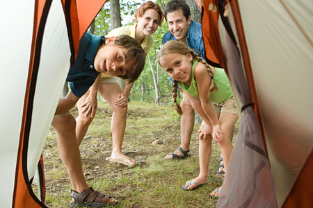 tween boy: Family looking into tent