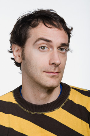 raised eyebrow: Portrait of mid adult Caucasian man Stock Photo