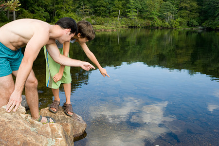 image source: Boy and father looking at lake Stock Photo