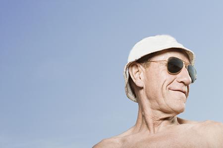 sunhat: Man wearing sunhat and sunglasses Stock Photo