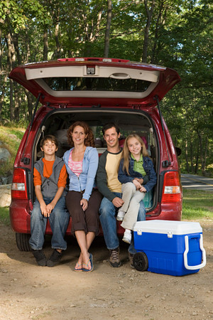 two generation family: Family sitting in back of car Stock Photo