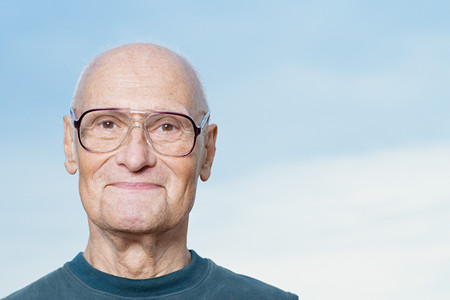 man looking at sky: Portrait of a senior man Stock Photo
