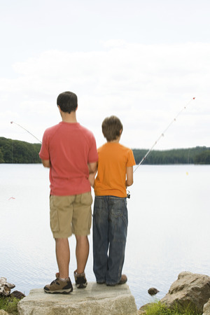 tween boy: Father and son fishing Stock Photo