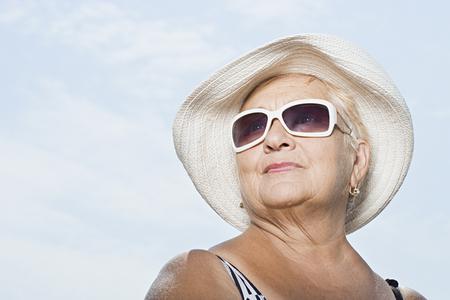 sunhat: Woman wearing a sunhat and sunglasses Stock Photo