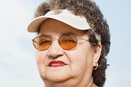 double chin: Woman wearing a sun visor