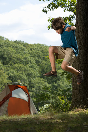tween boy: Boy jumping Stock Photo