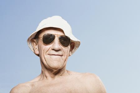sunhat: Man wearing a sunhat and sunglasses