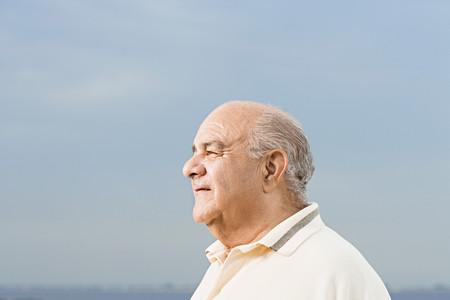 one senior adult man: Profile of a senior man Stock Photo