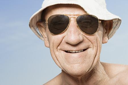 sunhat: Senior man wearing sunhat and sunglasses Stock Photo