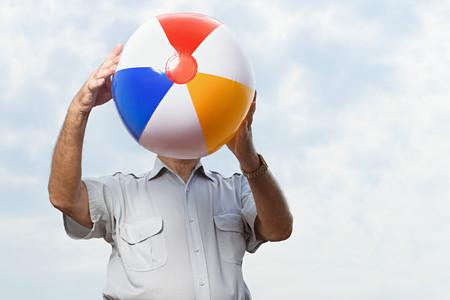 beachball: Man holding a beachball