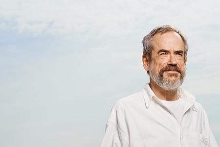 man looking at sky: Man thinking