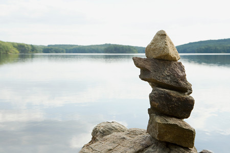 abandonment: Pile of rocks by a lake Stock Photo