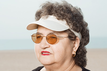 visor: Woman wearing a sun visor