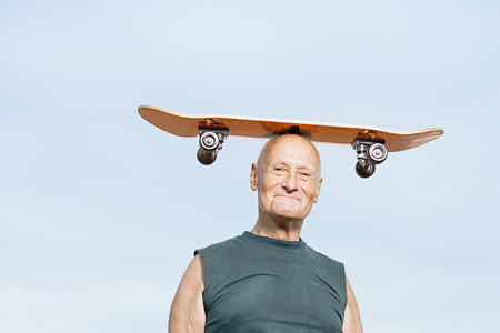 funny glasses: Man with skateboard on his head
