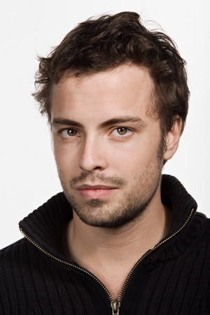 eyebrow raised: Portrait of young adult Caucasian man Stock Photo