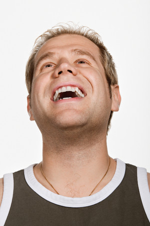 wife beater: Portrait of mid adult Caucasian man laughing