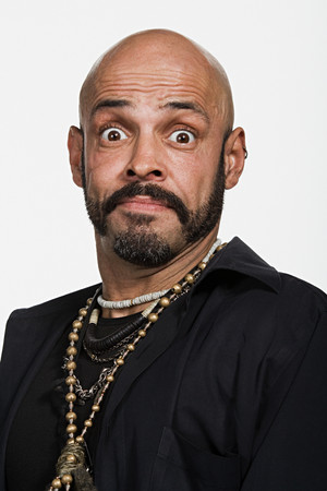 raised eyebrow: Portrait of mature adult Caucasian man