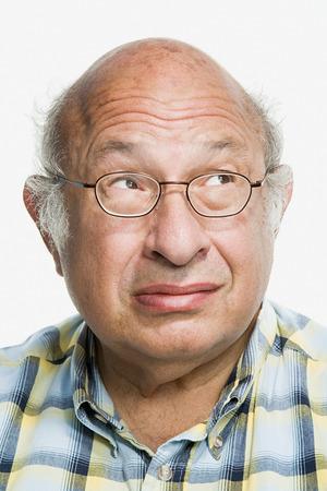 raised eyebrow: Portrait of a mature adult man