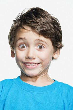 raised eyebrow: Portrait of young boy Stock Photo