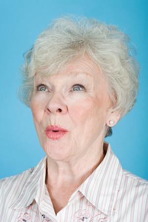 studio portrait: Surprised senior woman