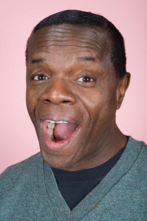 eyebrow raised: Portrait of a senior adult man