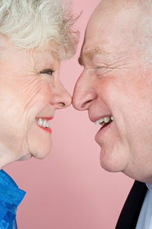 female portrait: Senior couple face to face