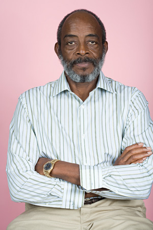 african ethnicity: Senior man with crossed arms