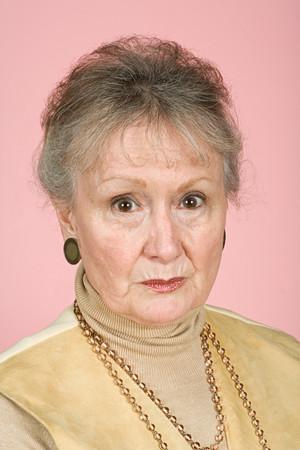 eyebrow raised: Portrait of a senior adult woman