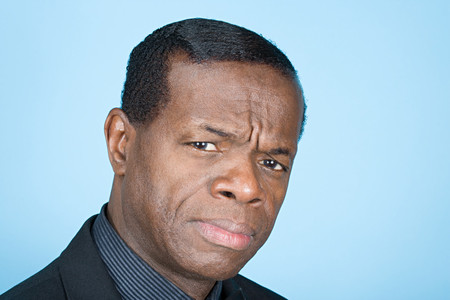 african man: Confused man Stock Photo