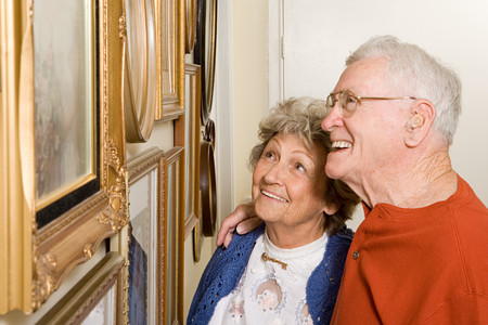 Senior couple looking at photographs Stock Photo