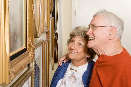 Senior couple looking at photographs Imagens
