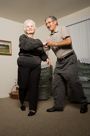 multi generational: Senior couple dancing Stock Photo