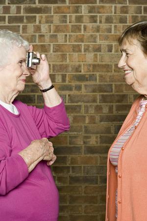 nursing sister: Senior woman taking a photograph Stock Photo