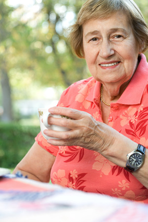 texas tea: Senior adult woman drinking tea