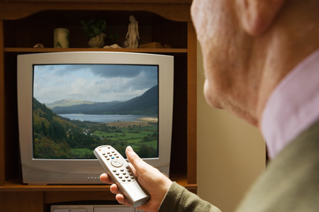 channel surfing: Senior man watching television