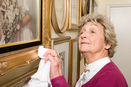 perfectionist: Woman polishing picture frames