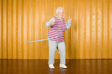 senior woman exercising: Senior woman exercising with a hoop Stock Photo