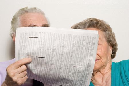 broadsheet newspaper: Elderly couple with newspaper Stock Photo