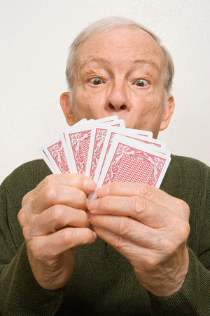 humor: Elderly man with playing cards Stock Photo