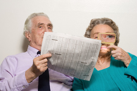 two visions: Elderly couple with newspaper Stock Photo