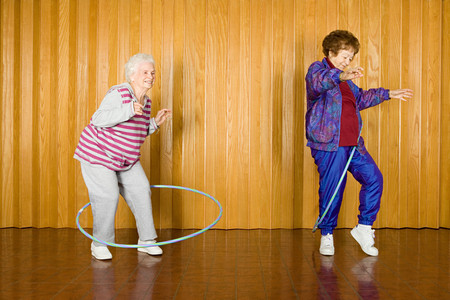 female senior adult: Two senior women exercising with hoops Stock Photo