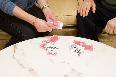 image source: Senior couple playing cards