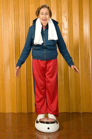 stood: Senior woman stood on scales
