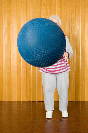 senior woman exercising: Senior woman exercising with a ball Stock Photo