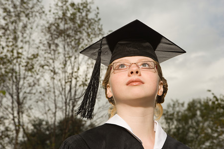 Female graduate looking up