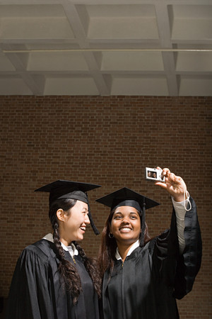 jamaican adult: Two female graduates taking a photograph Stock Photo