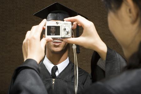 chinese american ethnicity: Graduates taking photographs